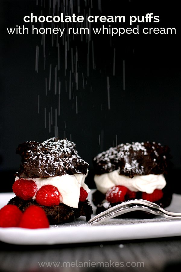 Whipped cream spiked with honey and rum, raspberries and chocolate ganache sandwiched between two halves of a chocolate cream puff.  These Chocolate Cream Puffs with Honey Rum Whipped Cream are layer upon layer of flavor that will have you asking for just one more bite.