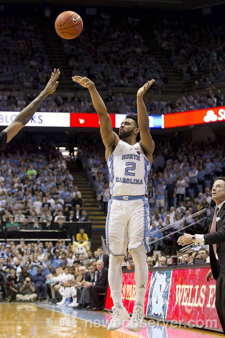 Louisville coach Rick Pitino watches as North Carolina's Joel Berry II (2) launches a three point shot during the first half against Louisville on Wednesday, February 22, 2017 at the Smith Center in Chapel Hill, N.C.