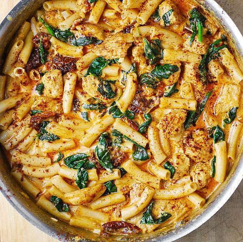 Asiago Chicken Pasta with Sun-Dried Tomatoes and Spinach Recipe Main Dishes with sun-dried tomatoes, chicken breasts, garlic cloves, salt, paprika, half & half, salt, asiago, penne pasta, fresh spinach