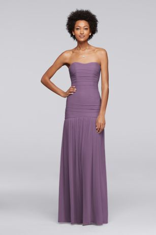 Looking for the perfect style to complement a mermaid wedding dress? Have your bridesmaids wear a toned down version of the silhouette. This strapless mesh fit-and-flare bridesmaid dress features a ruched bodice that elongates the torso.  Polyester  Back zipper; fully lined  Dry clean  Imported  Also available in Extra Length