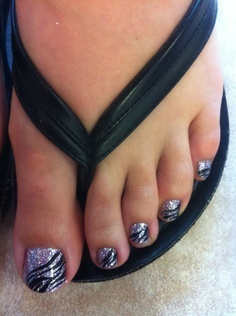 Glitter Zebra Pedicure.  ((Pinning for the nails but my first thought was that she really needs to be wearing a larger size shoe so that her toes all fit comfortably on the bottom there!))
