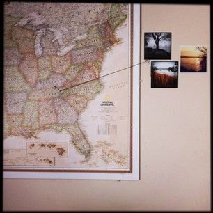 Display travel photos pinned to locations on a map. | 27 Unique Photo Display Ideas That Will Bring Your Memories To Life