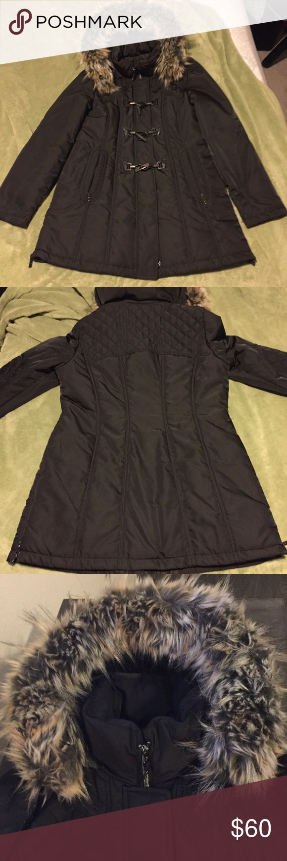 Warm Winter Coat from Germany This coat hits at mid thigh and it's so cute! It has a quilted detail on the shoulders and elbows and a detachable fur detail around the hood. This coat was purchased in Germany and is very flattering on the female body. gina Jackets & Coats Puffers