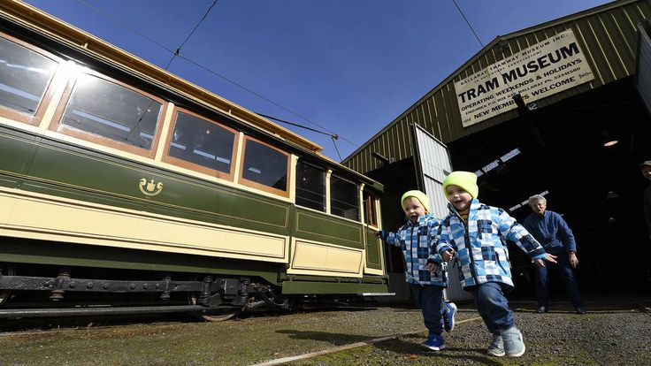 Twins Sam and Jack Carrucan race for a ride on a Ballarat tram as part of the National Trust Heritage Festival. Picture: JUSTIN WHITELOCK