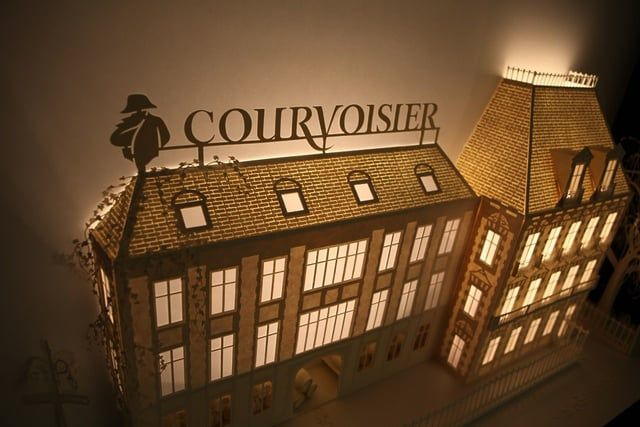 """Cognac house Courvoisier and creative agency White Label commissioned us to create a bespoke installation combining paper architecture and projection mapping to bring to life the brand's history, process and """"alchimie"""". The installation was unveiled as part of L'Atelier de Courvoisier; a reimagining of Courvoisier's Paradis aging cellar staged in Harrods, London, and it has now found its home at Courvoisier's château in Jarnac. 'The award-winning husband-and-wife team have built a reputat..."""
