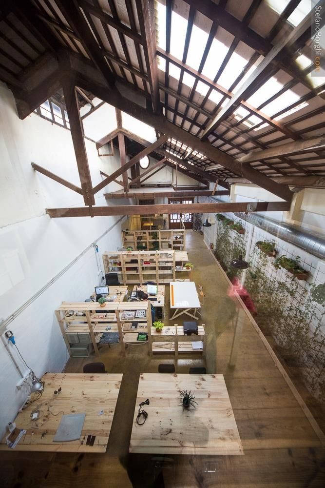 A divided yet open working space. Pity that I can't find information about the location.: