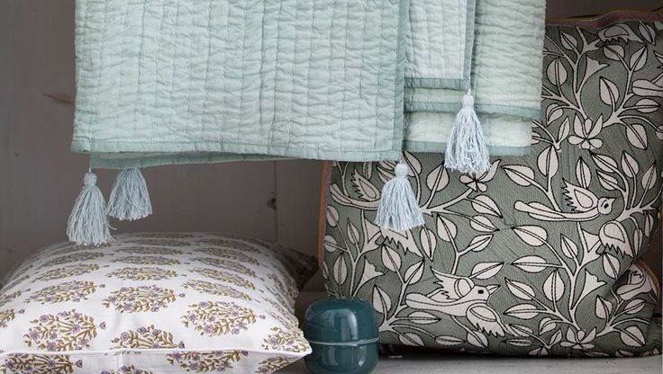 Quilts and embroided pillows