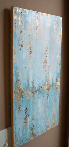 Original 12x24 Abstract painting with neutrals and light teals and accented with gold foil Painting is protected with a high-gloss finish