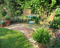 creative small brick patio | Garden design by designer Falmouth South West Cornwall | Town Family Garden