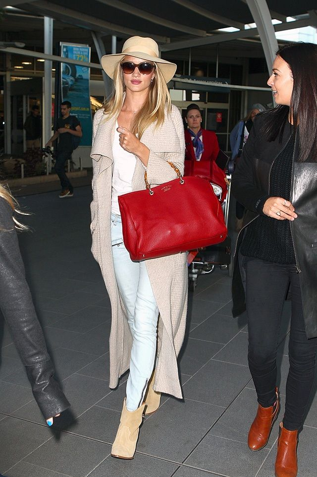 Red Gucci handbag and floppy hat | Rosie Huntington-Whitely's Airport Style