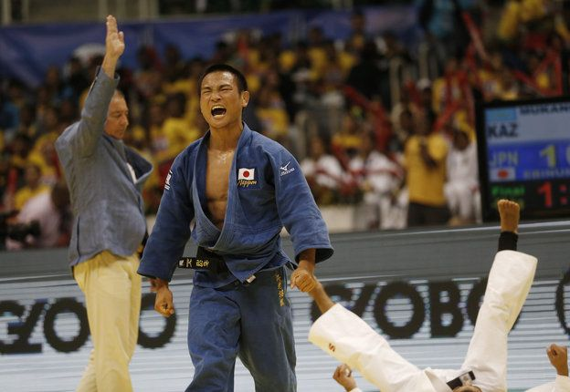 Japan's Masashi Ebinuma celebrates his victory over Azamat Mukanov from Kazakhstan after their men's - 66 kg final fight at the World Judo Championships in Rio de Janeiro, Brazil, Tuesday, Aug. 27, 2013. Ebinuma won the gold. (AP Photo/Silvia Izquierdo)