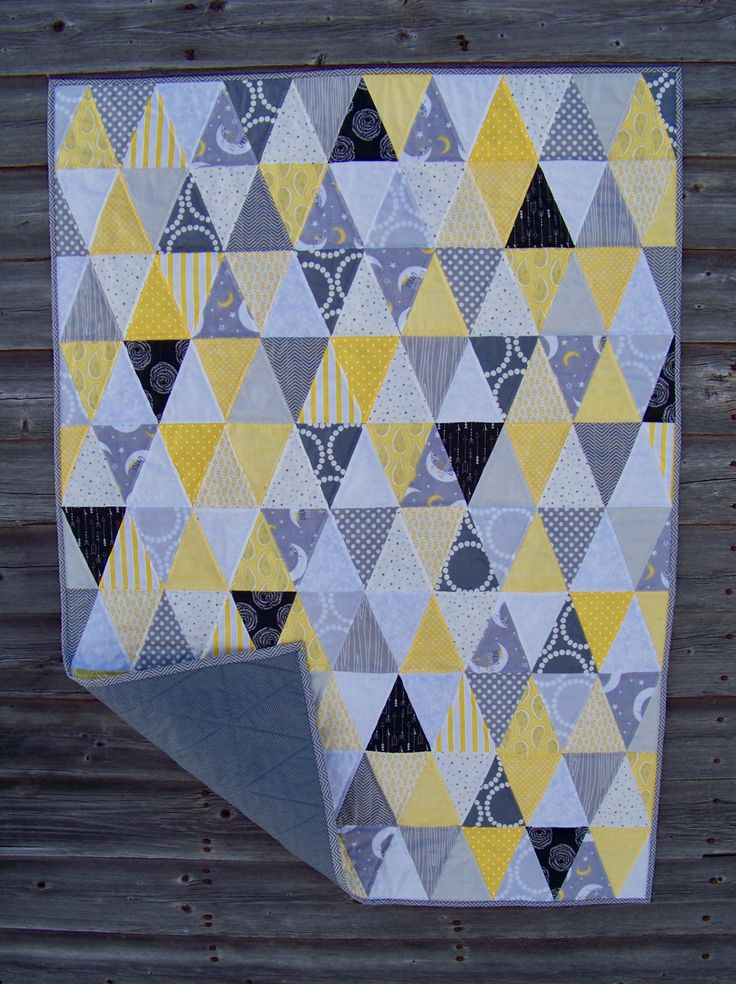 """Colleen: Here is my latest quilt finish. My husband named it """"The Chocolate Quilt"""". It is my first isosceles triangle project. I cut a lot of triangles and started arranging them on my design w…"""