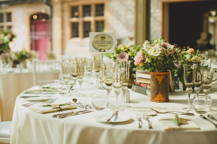 Swallows and Damsons flowers and wedding venue dressing at Thornbridge Hall. Wild garden flowers and books, containers, tins, vintage style.  www.tobiahtayo.com