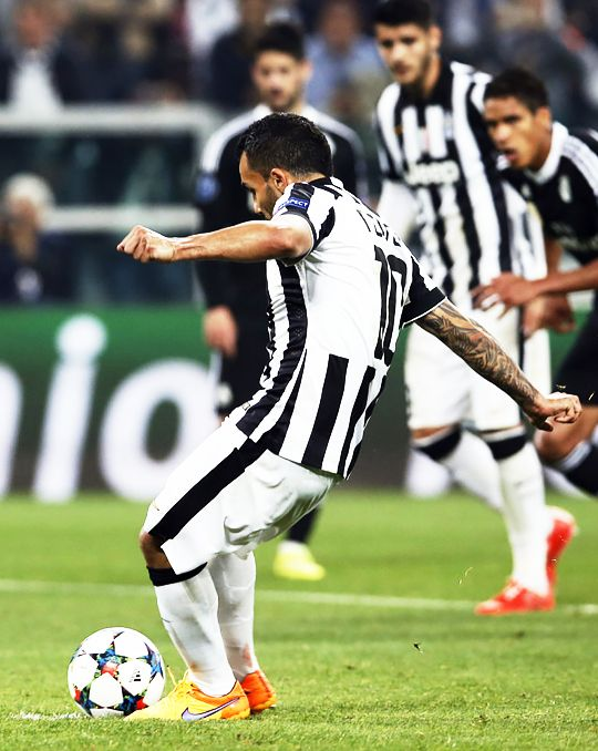 Juventus' Carlos Tevez scores on a penalty kick during the Champions League, semifinal soccer match between Juventus and Real Madrid at the Juventus Stadium in Turin, Italy, Tuesday, May 5, 2015.