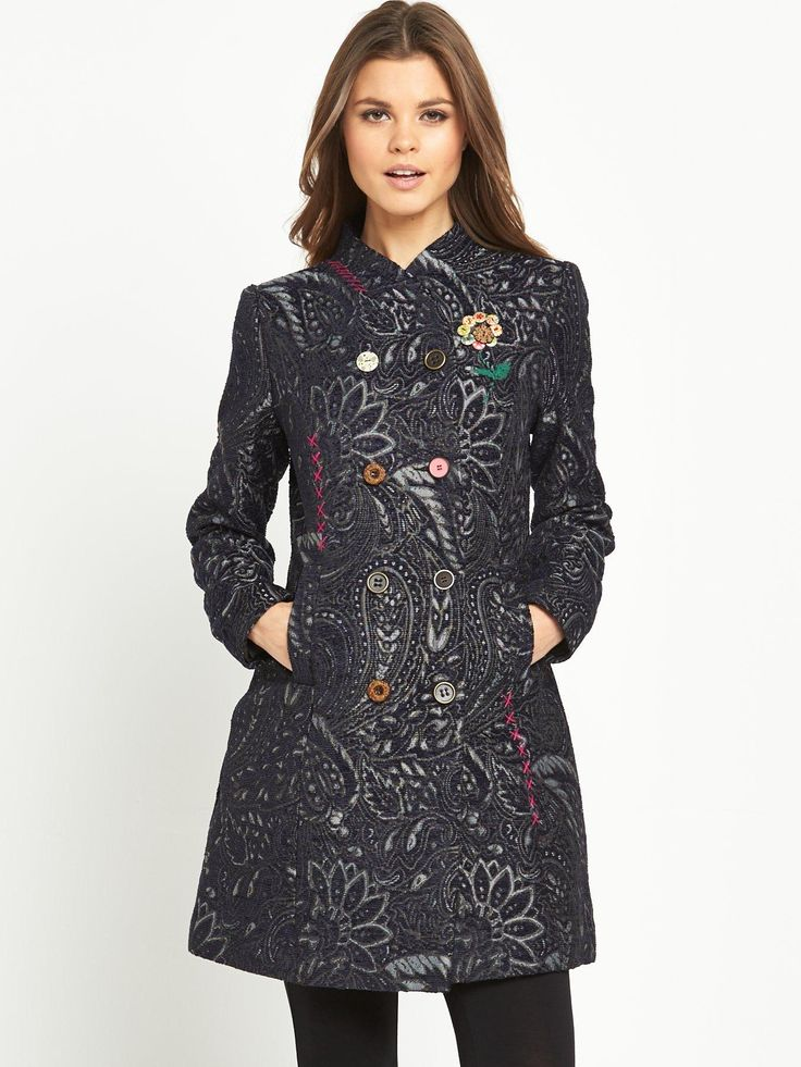 Joe Browns Luxurious Jacquard Coat A stylish finishing touch to any outfit this season, the Luxurious Jacquard coat by Joe Browns puts a quirky spin on a sophisticated style.Beautifully tailored, this cover up creates a flattering fit, while embroidery detailing and classic Joe mixed buttons adds a little colour and fun to a very charming and timeless piece.Fasten it up over one of Joe's tunics with leggings and ankle boots for a beautiful weekend look.Length: 90 cm.Washing Instructions…