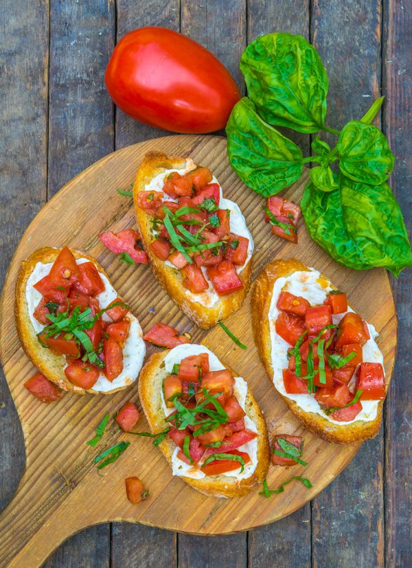 Tomato Mozzarella And Basil Bruschetta - tomatoes - fresh basil - extra virgin olive oil - balsamic vinegar - fresh mozzarella - baguette