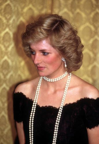 Princess Diana in 1987. Diana, the Princess of Wales, photographed at a 1987 dinner in Hamburg Germany. Diana wore a Victor Edelstein gown and a long string of pearls..