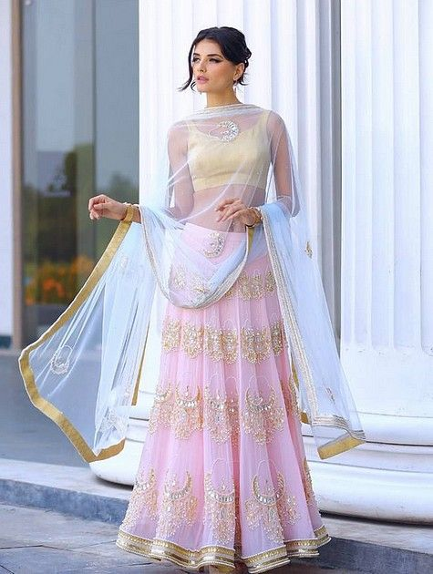 BABY PINK AND GOLD LENGHA  This Elegant baby Pink,Gold and white Lengha is the ultimate attire of elegance. A divine piece embroidered with golden laces, sequins, stones and beads. It includes the beautiful golden blouse and the stunning white Duppata.