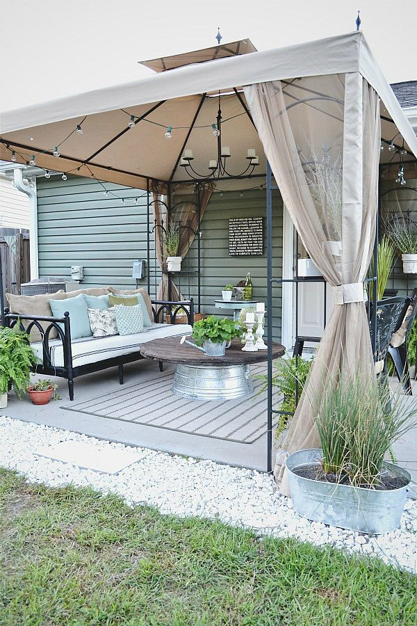 Back patio makeover- use thrifted items to make a space beautiful. You do not have to spend a lot of money to make your space beautiful!