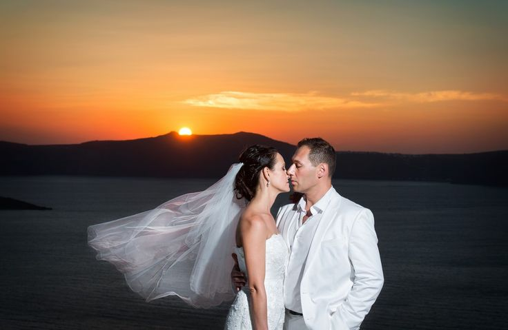 Amazing sunset caldera cliff Santorini what a place for a wedding