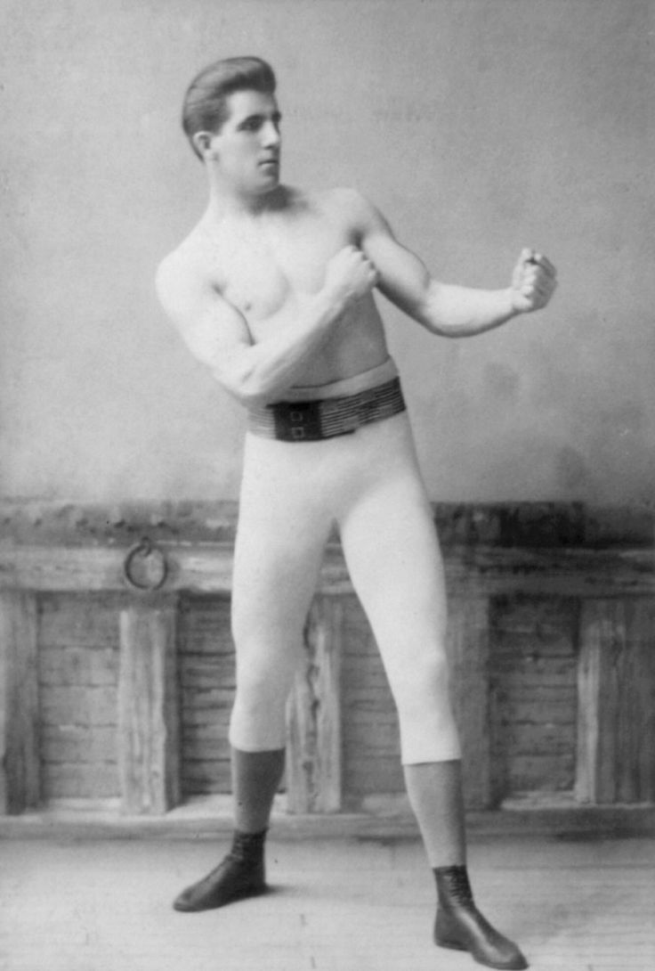 "James John ""Gentleman Jim"" Corbett (September 1, 1866 – February 18, 1933) was an Irish-American heavyweight boxing champion, best known as the man who defeated the great John L. Sullivan. He also coached boxing at the Olympic Club in San Francisco. He stood at 6 ft 1 in (1.85 m), with a reach of 73 inches (185 cm)."