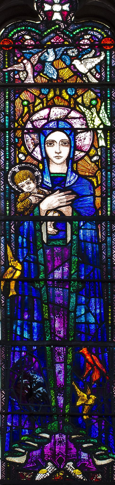 https://flic.kr/p/DpfEwk | NANTWICH, St Mary.   Harry Clarke. | One of very few windows in England designed by Harry Clarke.   This dates from 1919 and represents the Virgin & Child with St Cecilia on the left and Richard Coeur de Lion on the right, and is in memory of Mildred Clare Knowles who died in 1913 (and loved music, hence St Cecilia) and of her son, Richard Knowles who was killed in action in 1918.  Detail: Virgin & Child.