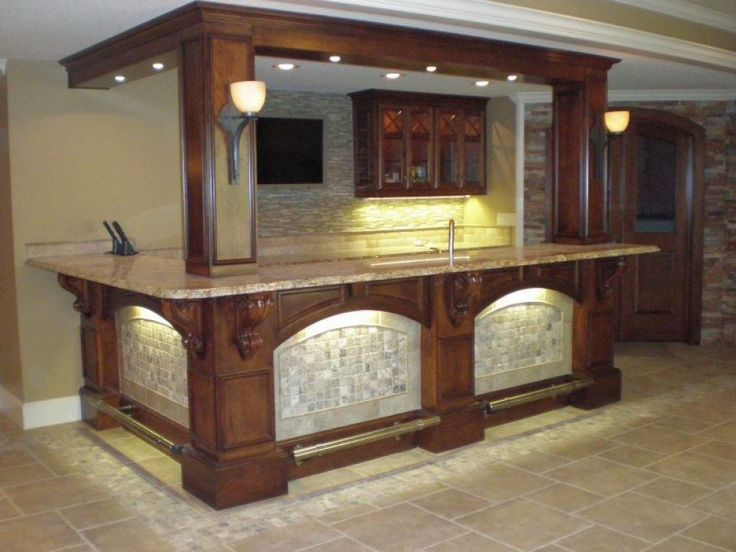 Here's a beautiful custom basement bar with a unique ...