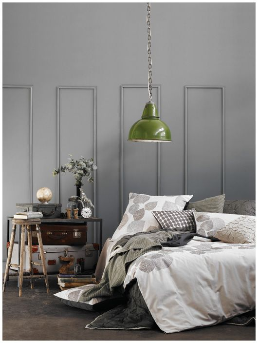 grey wall, green pendant, suitcases