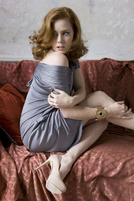 Amy Adams in a gray dress and sexy high heels