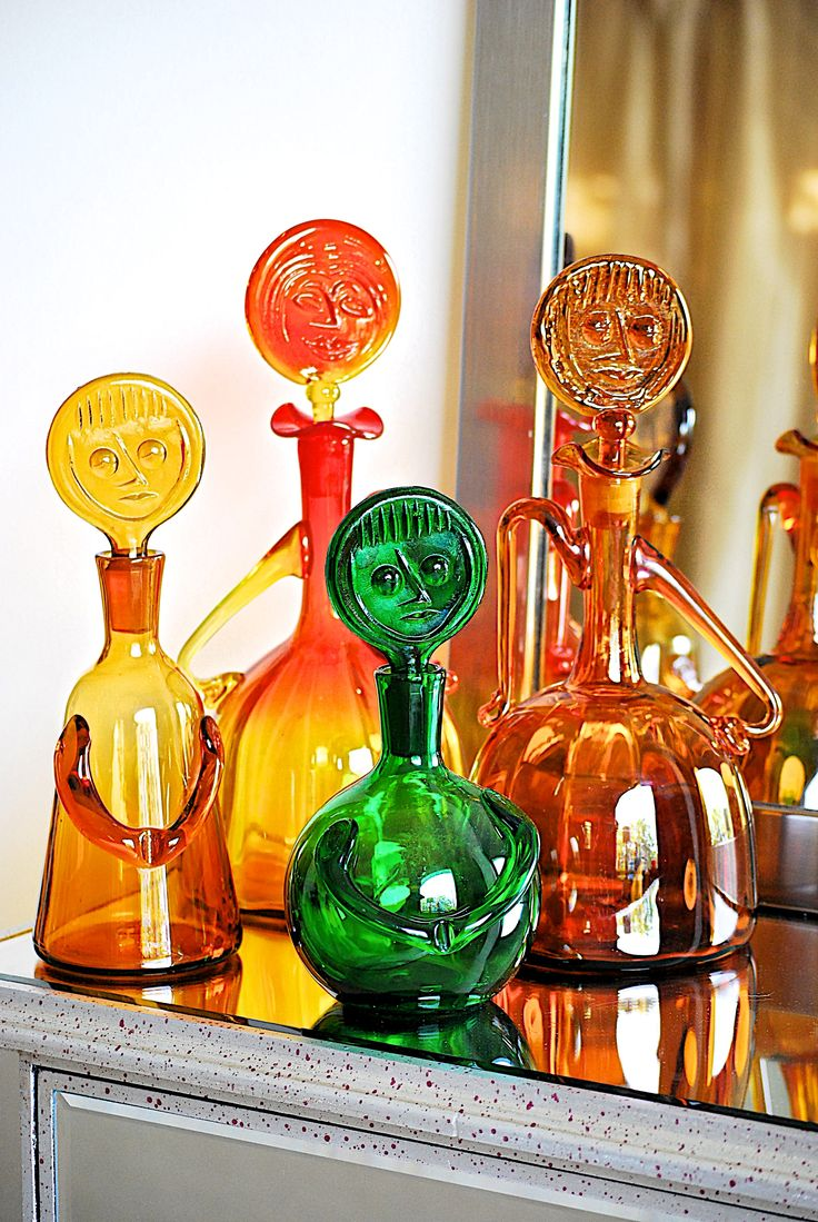 """Two vintage Blenko #6525 lady with face decanters designed by Wayne Husted. One is tangerine in color and the other is in wheat. The decanters stands about 13 1/4"""" tall. Two vintage Erik Hoglund """"People"""" Decanters. Taller decanter with stopper in place measures 11"""" x 4"""". Shorter decanter with stopper in place 9.5"""" x 5"""". Photography by NikoDeleon.com"""