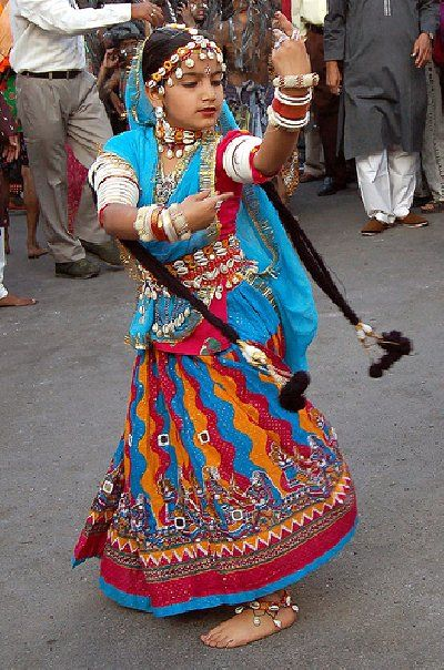 A little girl dancing in public in Rajasthan probably to make money.