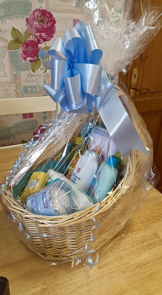 Baby Boy Hamper in a Basinett basket full of goodies