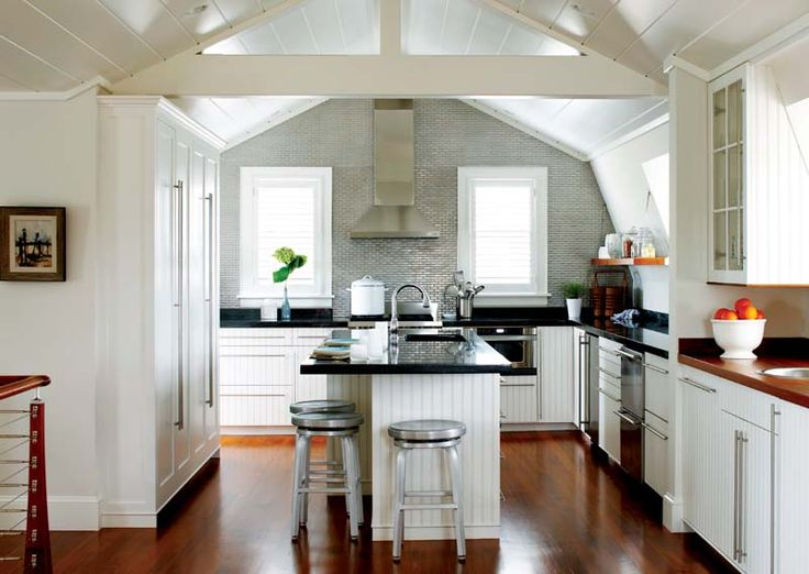 The soft, gray tile wall showcases that barn style architecture bringing another pattern into the design as well as slightly contrasting the colors.