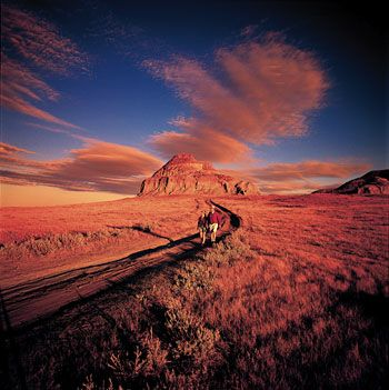 Big Muddy Badlands & The Outlaw Trail, Saskatchewan  Castle Butte, a 60-metre (196 ft) outcrop of compressed clay, rises suddenly from the surrounding landscape. Castle Butte's Ayer's-Rock-like presence on the relatively flat prairie announces the Big Muddy Badlands