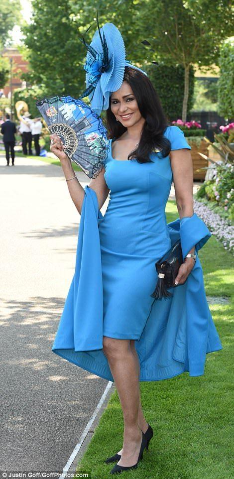 Feeling blue! Bruce Forsyth's wife Wilnelia, Lady Forsyth-Johnson keeps cool in the heat with a handy fan