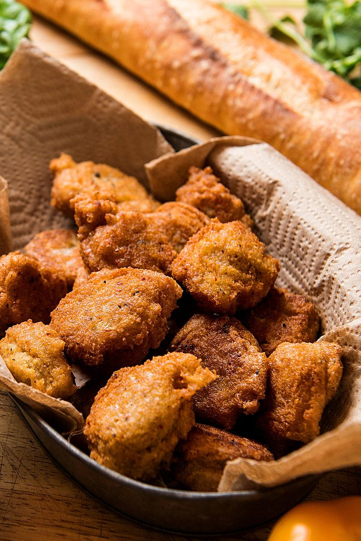 The chef Pierre Thiam puts a twist on these traditional Senegalese accara, or black-eyed pea fritters. They are sold on street corners throughout West Africa, usually on fresh baguettes as a sandwich. (Photo: Evan Sung for The New York Times)