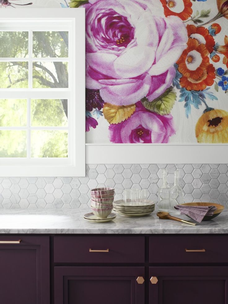Lower cabinets pick up the deep plum color of the poppies and peonies in the wallpaper.