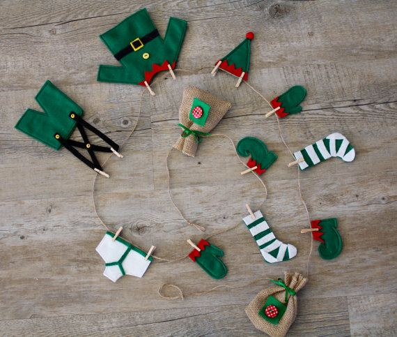 This was designed & handcrafted by me.  This Elfs Washing Line, is an original Christmas garland that would look great on the wall, over a mantelpiece or dresser or hung with your Christmas stockings. There are 12 items of clothing hand crafted in felt and hung onto the jute string clothes lines with little clothes pegs. The clothes measure between 5-15cm. The garland has loops at each end for easy hanging and is approximately 165cm in length. The length is adjustable & the clothes can be…