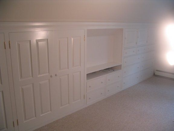 storage along knee wall - beautiful for master bedroom. love that there is a spot for the tv.