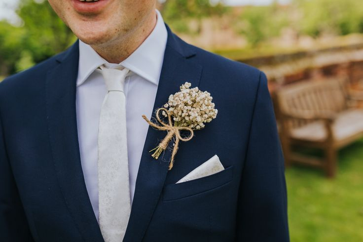 Smart blue suit with ivory tie and pocket square and gypsophila buttonhole. Photo by Benjamin Stuart Photography #weddingphotography #groom #suit #groomsmen #weddingday #buttonhole #ivorywedding #gypsophila