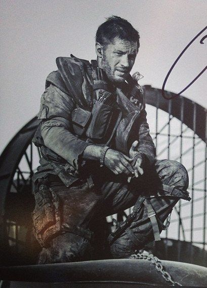 A closer look at this still from Mad Max Fury Road which Tom seems to have handed out to the crew of the film.