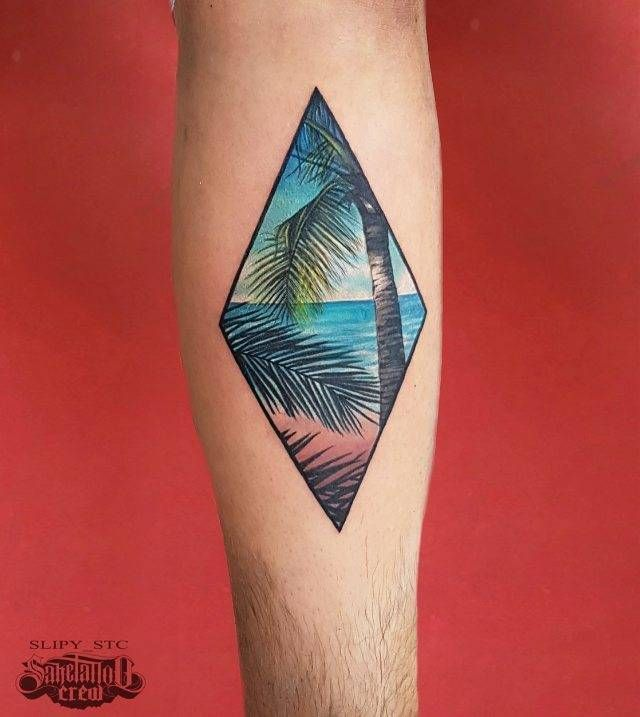 Beach landscape rhombus tattoo on the left inner forearm.                                                                                                                                                                                 More