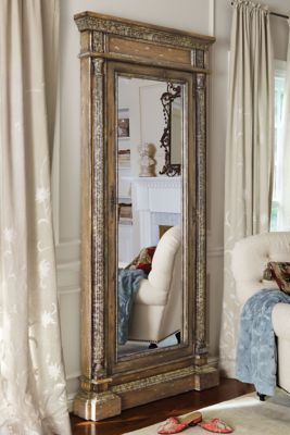 At first glance, it's a stately floor mirror. But upon closer inspection, behind this gorgeous looking glass is a clever and secure jewel safe.Within, the spacious interior is lined with black velvet and outfitted with ring holders, necklace hooks and bars for holding earrings. | Soft Surroundings