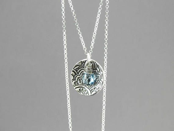 Topaz and silver disc pendant