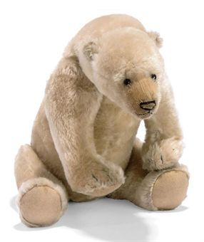 A STEIFF POLAR BEAR, (8335,2), jointed, mohair, black boot button eyes, black stitching, ball-jointed neck, in-operative growler and FF button, circa 1910 --14in. (35cm.) long (some slight thinning, missing a few nose stitching strands)