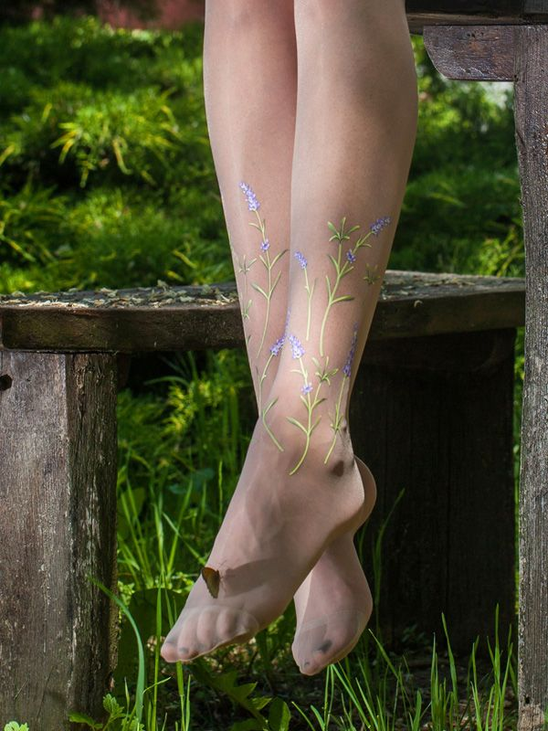Beautifulvintage patternlavender tights.   Superb quality thin sheer tights with printed lavenderpattern on the legs (one side only).   The material is 20 denier, super thin but really elastic thanks to its Lycracontent. It is light nude, but it is so thin, that fits to most (Caucasian) skin tones.