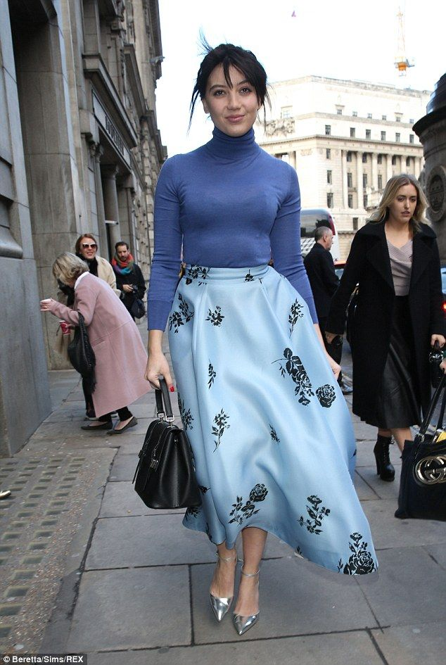 Feeling blue? Model Daisy wowed as she donned a light blue full skirt and complementing darker blue knit