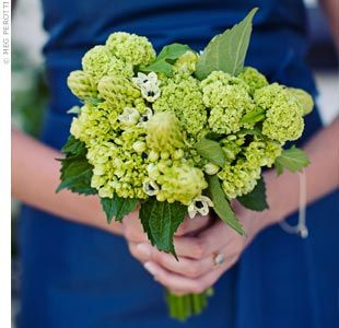 All-green bouquets (of mostly viburnum) pop against bridesmaid dresses.