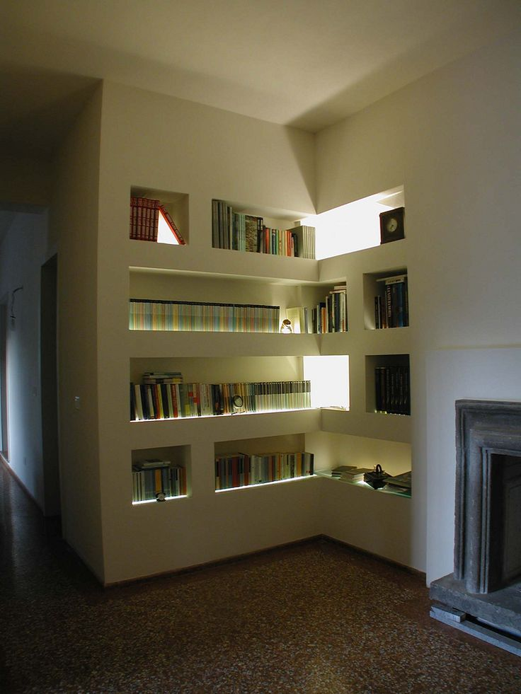 Beatiful library realized with Plasterboard , glass an light, design by Ghedini Studio