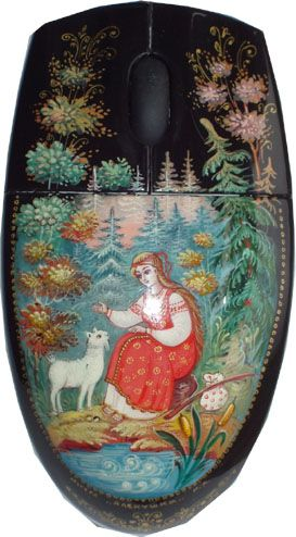 A computer mouse is decorated with Russian lacquer miniature from the village of Mstyora. A scene from the fairy tale: sister Alyonushka with her brother Ivanushka, who has been transformed into a little goat by a wicked witch.